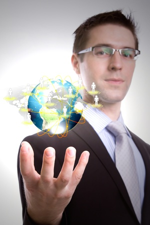 Business man hold earth of social network photo