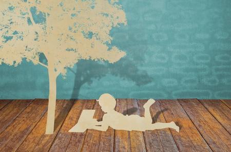 Paper cut of children read a book under tree photo