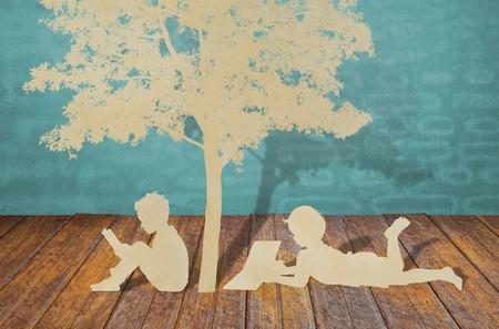 kids reading book: Paper cut of children read a book under tree
