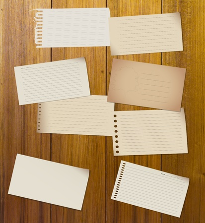 scribbling: Paper Sheets set on wood floor