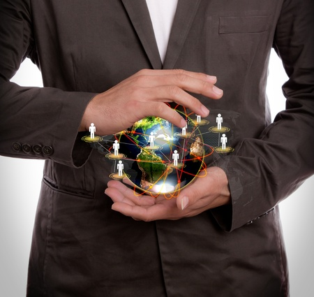 Business man hold earth of social network Stock Photo - 12343515