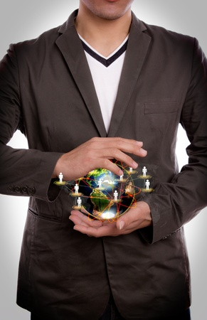 Business man hold earth of social network Stock Photo - 12343522