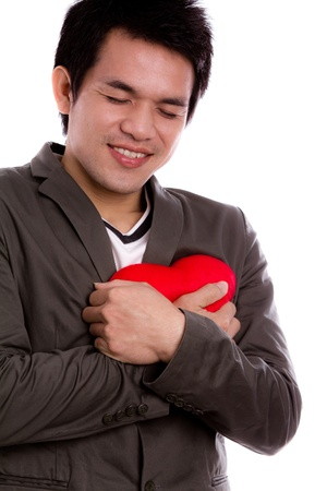 congenial: Business man with red heart isolated on white Stock Photo