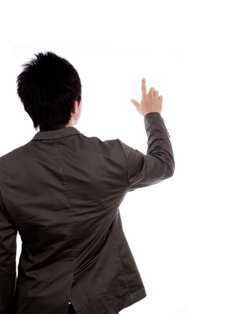 Back view of a young business man pointing at something over white background photo