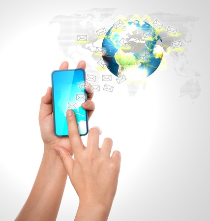 Hand holding a phone show Earth and mail Stock Photo - 12343787