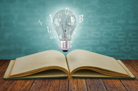 understand: Book and light bulb Stock Photo