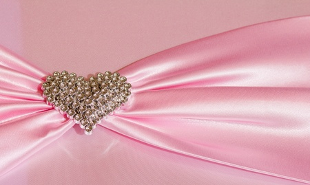 tsavorite: Heart shape diamond on pink fabric