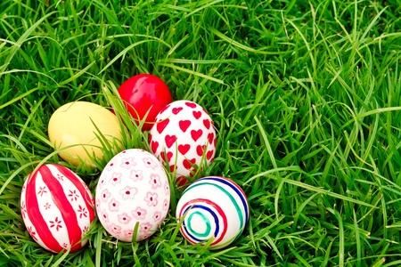 Easter Eggs  on Fresh Green Grass photo