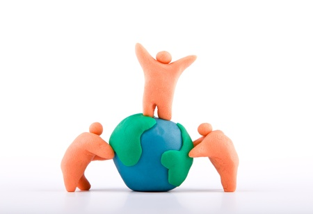 Plasticine of people embracing the earth photo