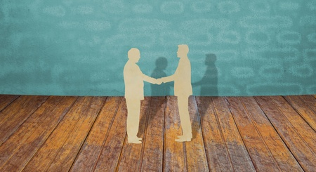 cross cut: Paper cut of two business man shake hand