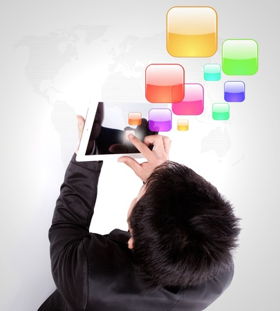 Business man using a touch screen device with colorful application icons photo