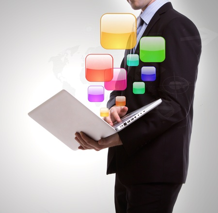 Business man with laptop Stock Photo - 12775761