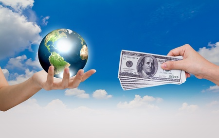 Hand exchange the world with Dollar over blue sky photo