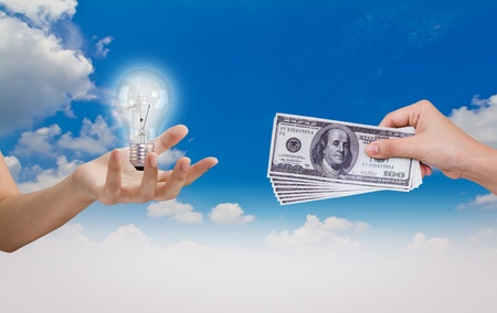 Hand exchange Idea (Bulb)with Dollar over blue sky photo