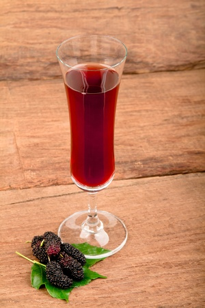 Mulberry juice in the glass photo