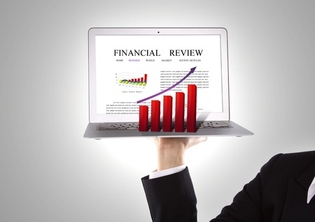 Business people hold Laptop with red graph photo