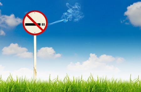 abstain: No smoking sign on fresh spring green grass