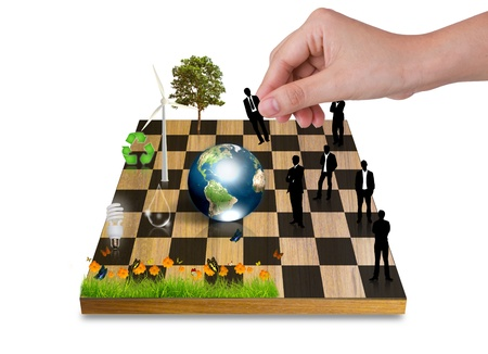 games hand: Hand Playing chess game with Silhouettes of business people vs nature  Stock Photo