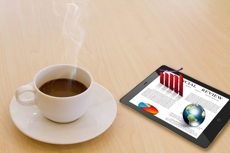 Touch screen device and cup of coffee (Elements of this image furnished by NASA) photo