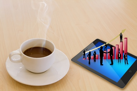 Touch screen device and cup of coffee Stock Photo - 13213450