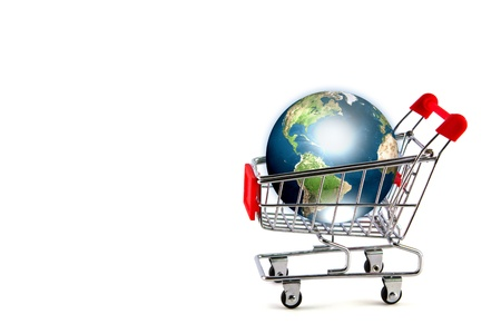 Global shopping concept with shopping cart photo