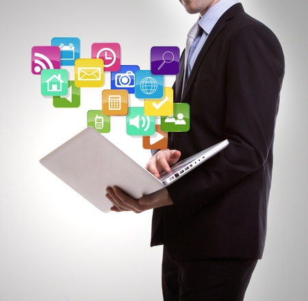 Business man with laptop and colorful application icons photo