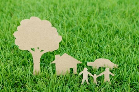 clean environment: Paper cut of family with house , tree and car on fresh spring green grass Stock Photo