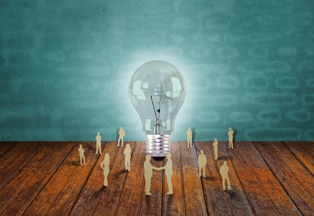 Paper cut of business people and light bulb Stock Photo - 13248922