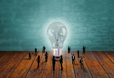 Silhouettes of business people  and light bulb Stock Photo - 13248921