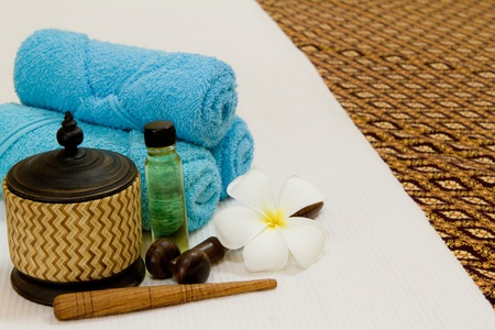 Health spa with white flower ,bottles with essential oil Stock Photo - 13292793