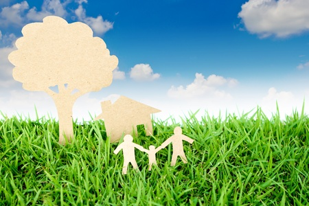 cut paper: Paper cut of family with house and tree on fresh spring green grass Stock Photo