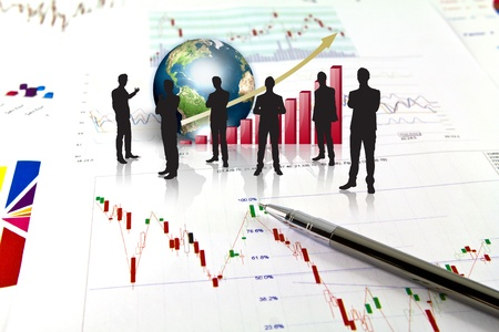 Silhouettes of business and business graph with earth (Elements of this image furnished by NASA) Stock Photo - 13446078