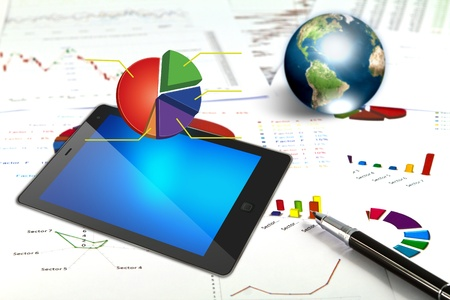 Touch pad and financial Graphs  (Elements of this image furnished by NASA) photo