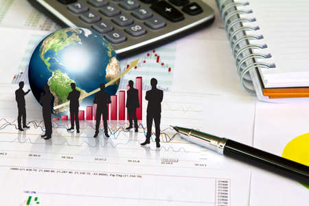 Silhouettes of business and business graph with earth (Elements of this image furnished by NASA) Stock Photo - 13608207
