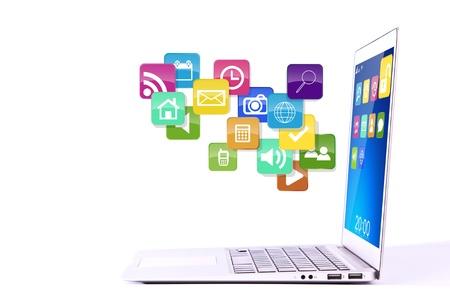 web application: Laptop con le icone delle applicazioni colorate isolato su sfondo bianco Archivio Fotografico