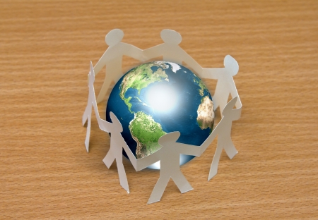 Paper cut of  people standing in a circle around globe on wooden floor  (Elements of this image furnished by NASA) Stock Photo - 13608206