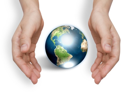 Two hands with earth  (Elements of this image furnished by NASA) photo