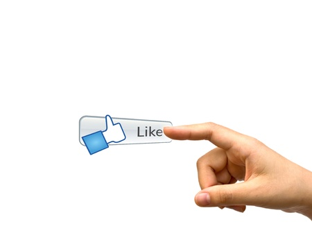 Hand pushing a Like button on a touch screen interface Stock Photo - 13629762