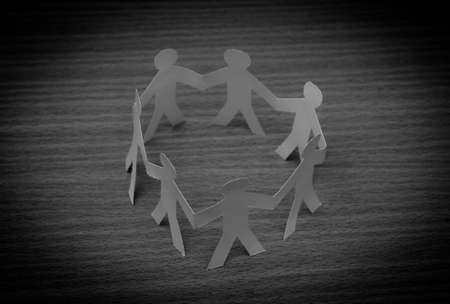 cross linked: Social Network concept : close up of people cut out of paper on wooden table Stock Photo