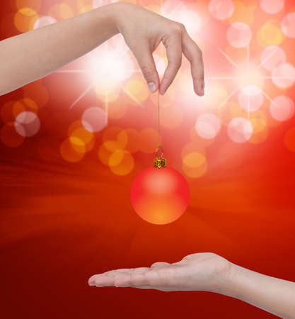 Human hand holding Transparent Christmas ball photo
