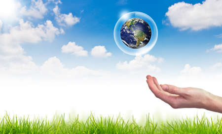 Eco concept : Hand hold globe in bubbles against the sun and the blue sky Stock Photo - 13638616