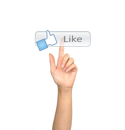 Hand pushing a Like button on a touch screen interface Stock Photo - 13625975
