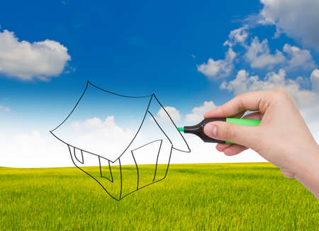 Business hand with pen drawing a house Stock Photo - 13639297