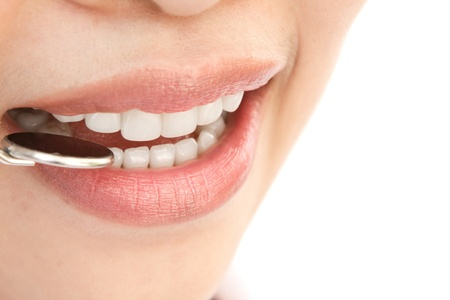 Healthy woman teeth and a dentist mouth mirror Stock Photo - 13625493