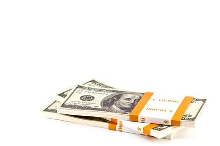 Ten thousand dollar stacks on the white Stock Photo - 13626117