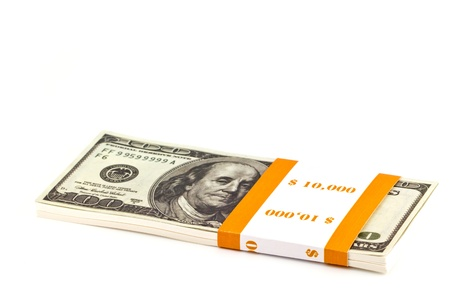 Ten thousand dollar stacks on the white Stock Photo - 13630057