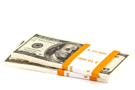 Ten thousand dollar stacks on the white Stock Photo - 13631048