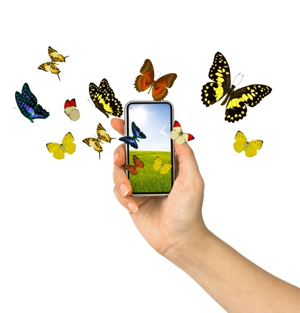 Butterfly reaches out of phone Stock Photo - 13632030