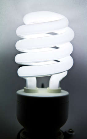 bright energy saving fluorescent light bulb photo