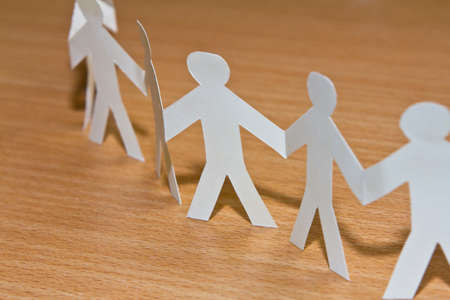 Cutout paper people Stock Photo - 13639310